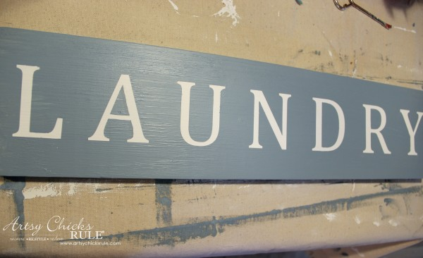Antiqued Laundry Sign - painted blue and vinyl letters removed - artsychicksrule #laundrysign #diylaundrysign